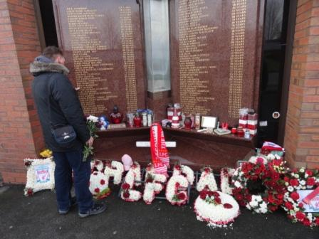 A relative says a prayer for one of the 96