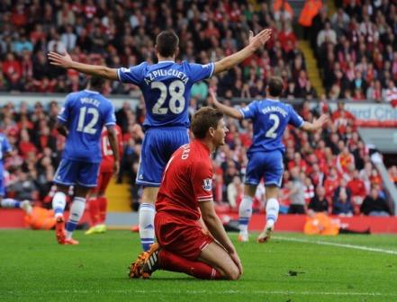 A despondent Gerrard after the final whistle against Chelsea (courtesy of sportskeeda.com)